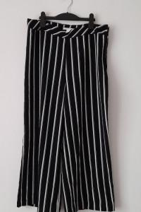 H&M Czarno białe szerokie spodnie w pasy 44...